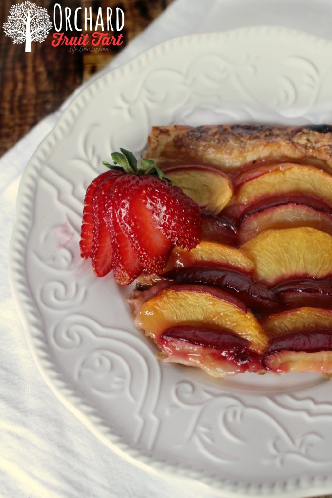 This Orchard Fruit Tart is a simple dessert made with all-butter puff pastry, necatarines, plums and peaches.  This is perfect for later summer!