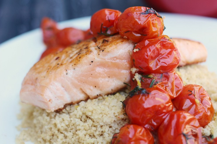 Salmon served with dilled tomatoes, lemon dill couscous and roasted heirloom carrots for a healthy and delicious summer family dinner!