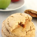 These Caramel Apple Cider Cookies feature an apple cider spiced cookie stuffed with ooey gooey caramel!