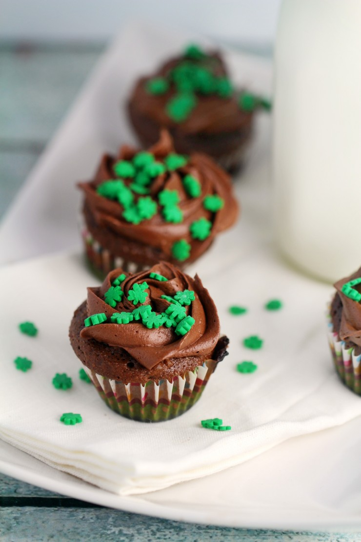 These Mini St. Patrick's Day Chocolate Mint Cupcakes are a great dessert to bring to any st patricks day parties. The tiny shamrocks make them just adorable!