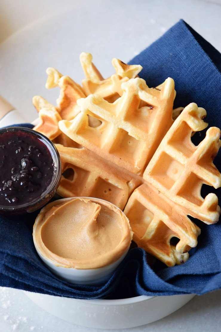 These golden, fluffy Peanut Butter and Jelly waffles are filled with creamy peanut butter and sweet jelly, mixed straight into the batter.