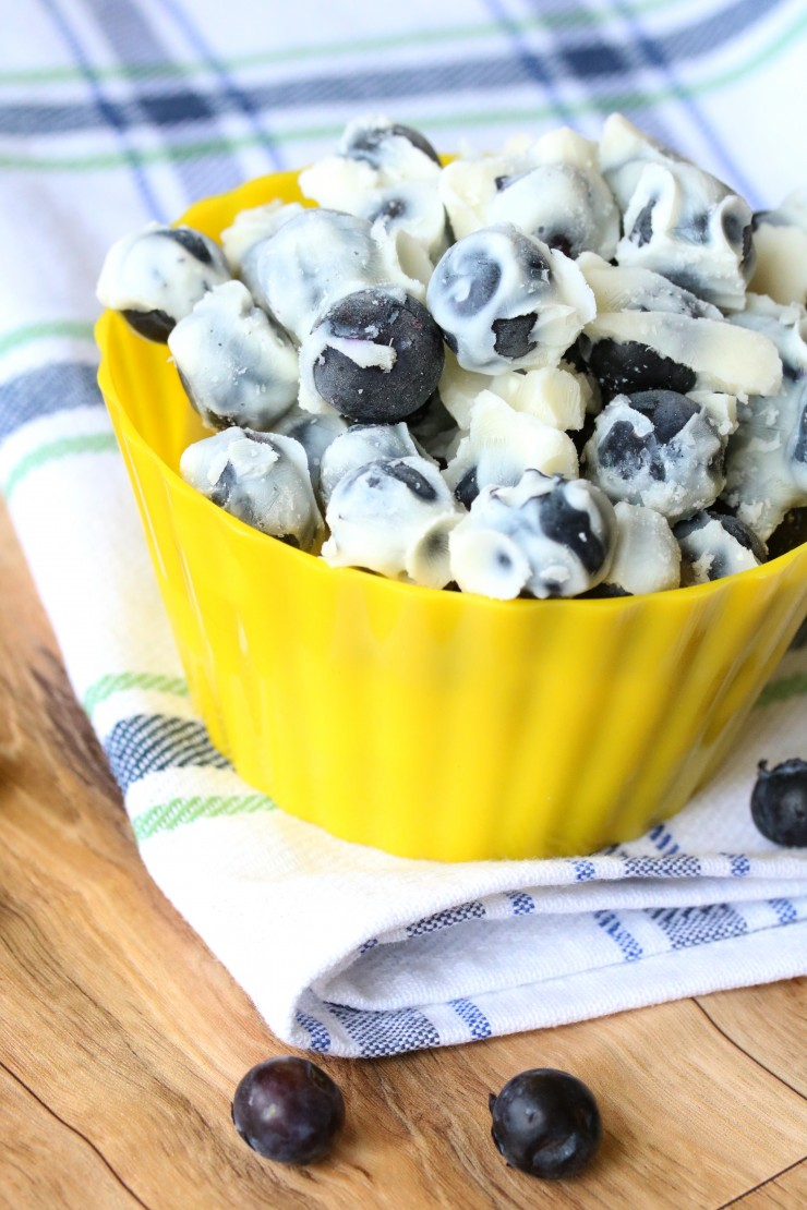 These Frozen Maple Yoghurt Blueberries make for a tasty summer treat. These little blueberry bites are easy to throw together and so very delicious. The yoghurt is a great way to have a more balanced snack with this cool treat.