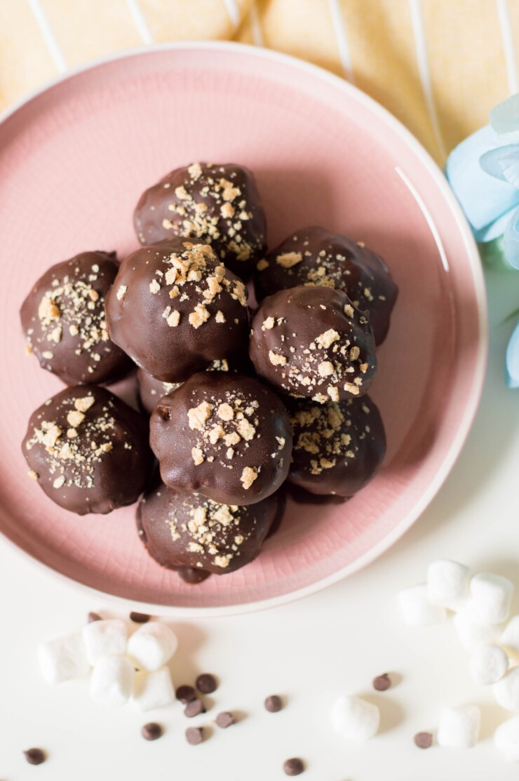 These Cookie Dough S'mores Truffles feature eggless cookie dough, studded with chocolate chips and mini marshmallows, dipped in melted chocolate, and then sprinkled with crushed graham crackers.