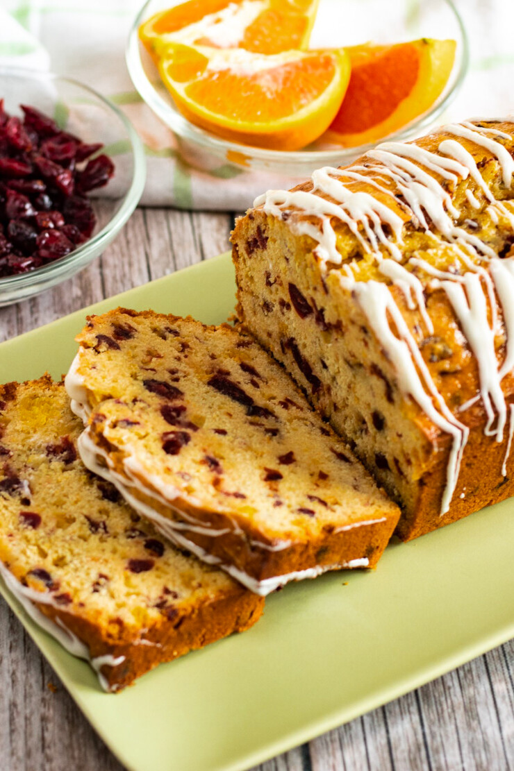Easy and delicious cranberry orange bread is packed with orange zest and cranberries and drizzled with an orange cream cheese icing.