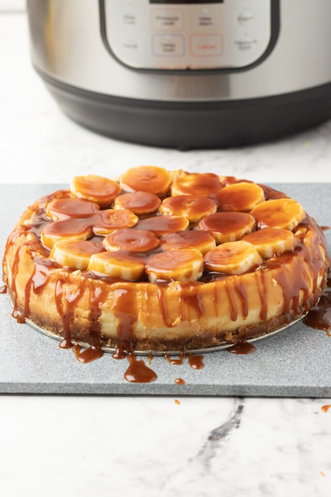 This Bananas Foster Cheesecake is made with a vanilla wafer crust that is then filled with a rum spiked banana cheesecake filling with a gooey bananas foster topping.