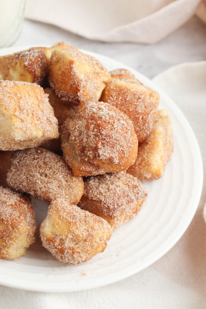 This Air Fryer Donut Bites recipe starts with canned biscuit dough for the easiest air fryer dessert you can make.