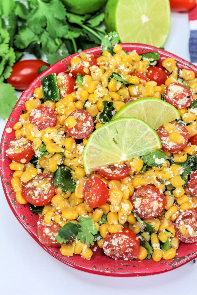 This Mexican Street Corn Salad, also known as Esquites, is fresh, lightly creamy, spicy, & incredibly delicious.