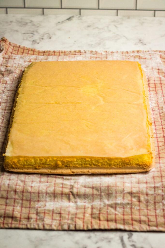 baked cake on a tea towel