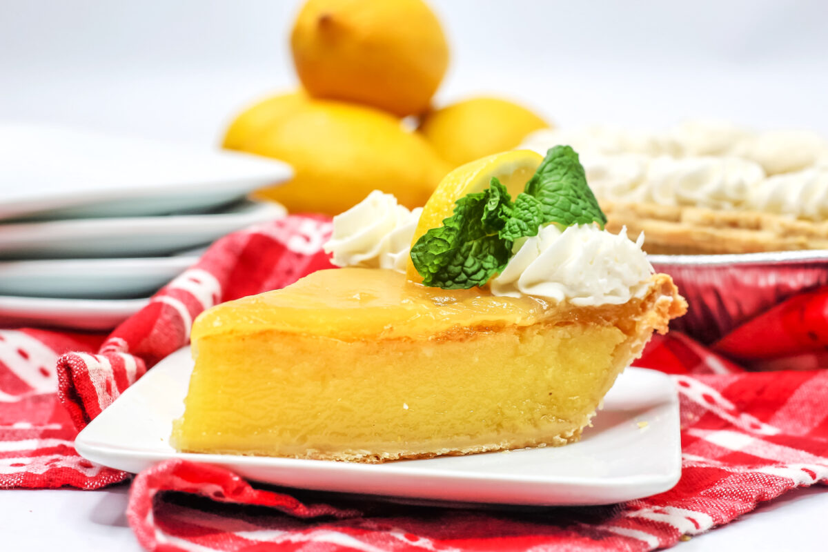 Smooth, custardy, tangy and sweet, this Lemon Chess Pie is made with the classic recipe then topped with lemon curd for the best Chess Pie!