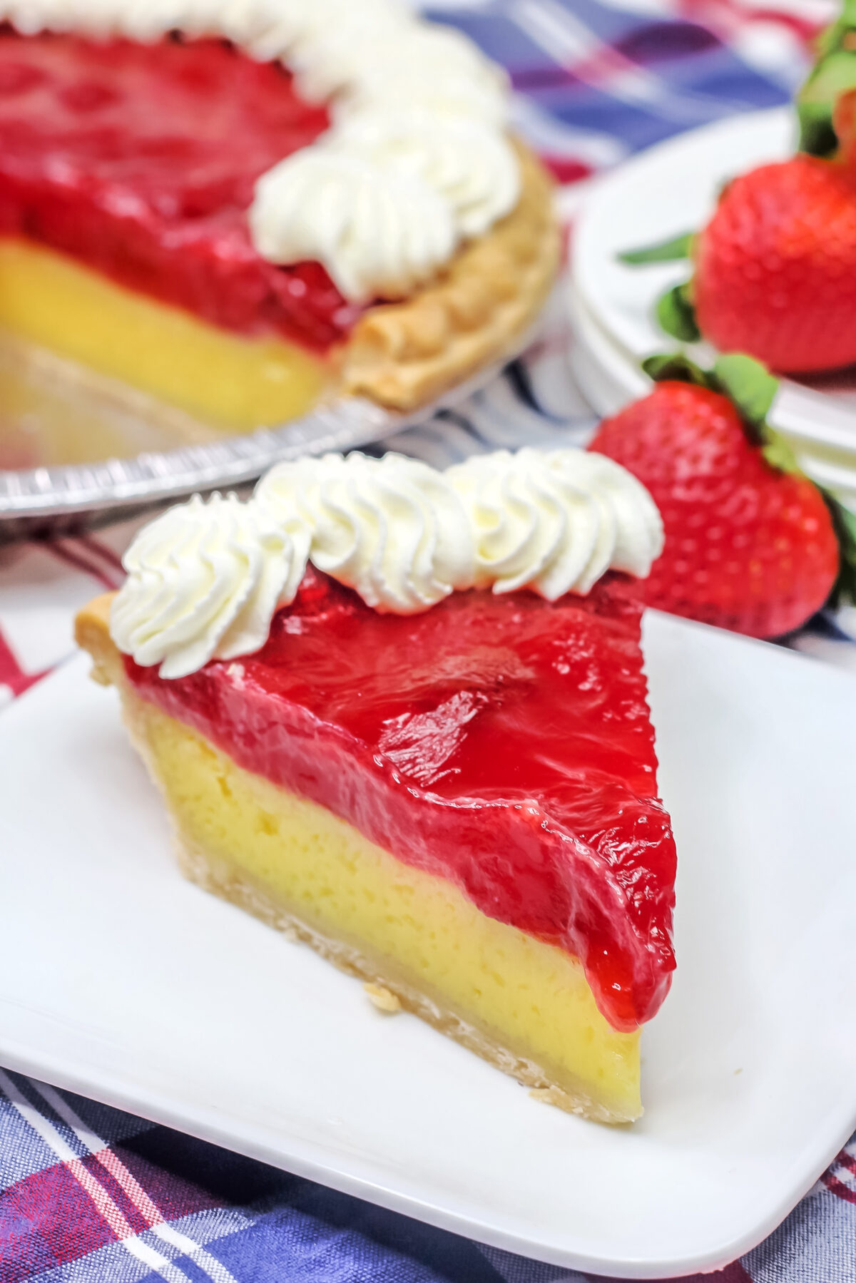 Smooth, custardy, tangy and sweet, this Strawberry Lemon Chess Pie is made with the classic recipe then topped with strawberry pie filling!