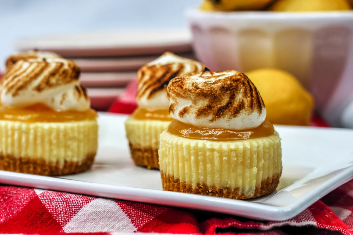These mini lemon meringue cheesecakes are small, but they pack a tangy punch. A delicious and easy to make dessert for any occasion.