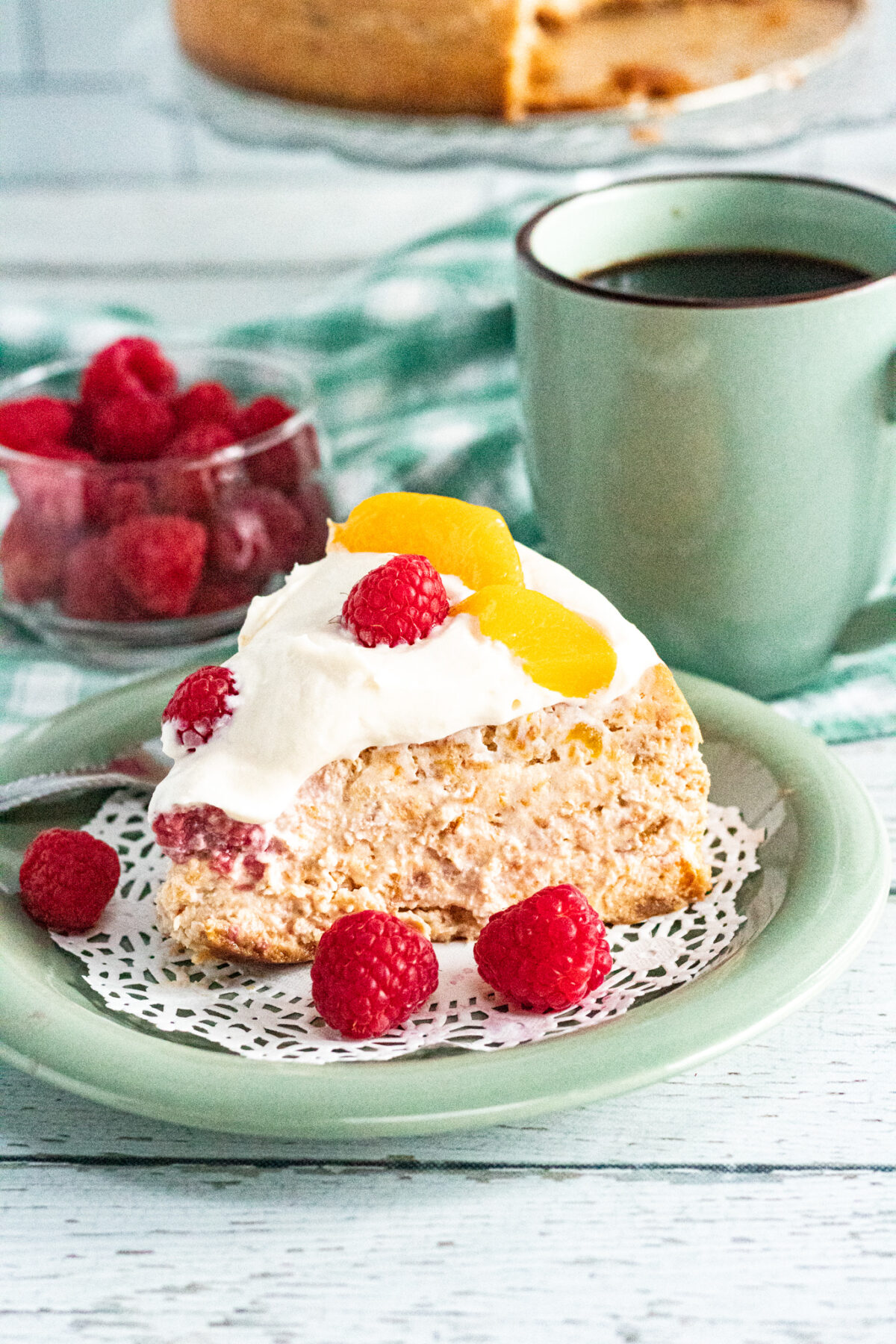 Sweet and creamy, this Instant Pot Peach Melba Cheesecake is filled with fresh peaches & raspberries then topped with a cream cheese frosting.