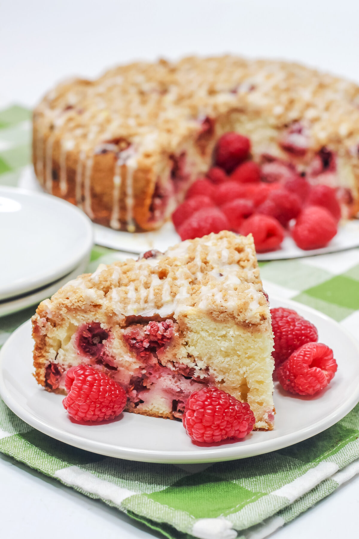 This Raspberry Crumble Cake features a tender cake dotted with fresh raspberries, topped with crumble, and drizzled over with a lemon glaze.