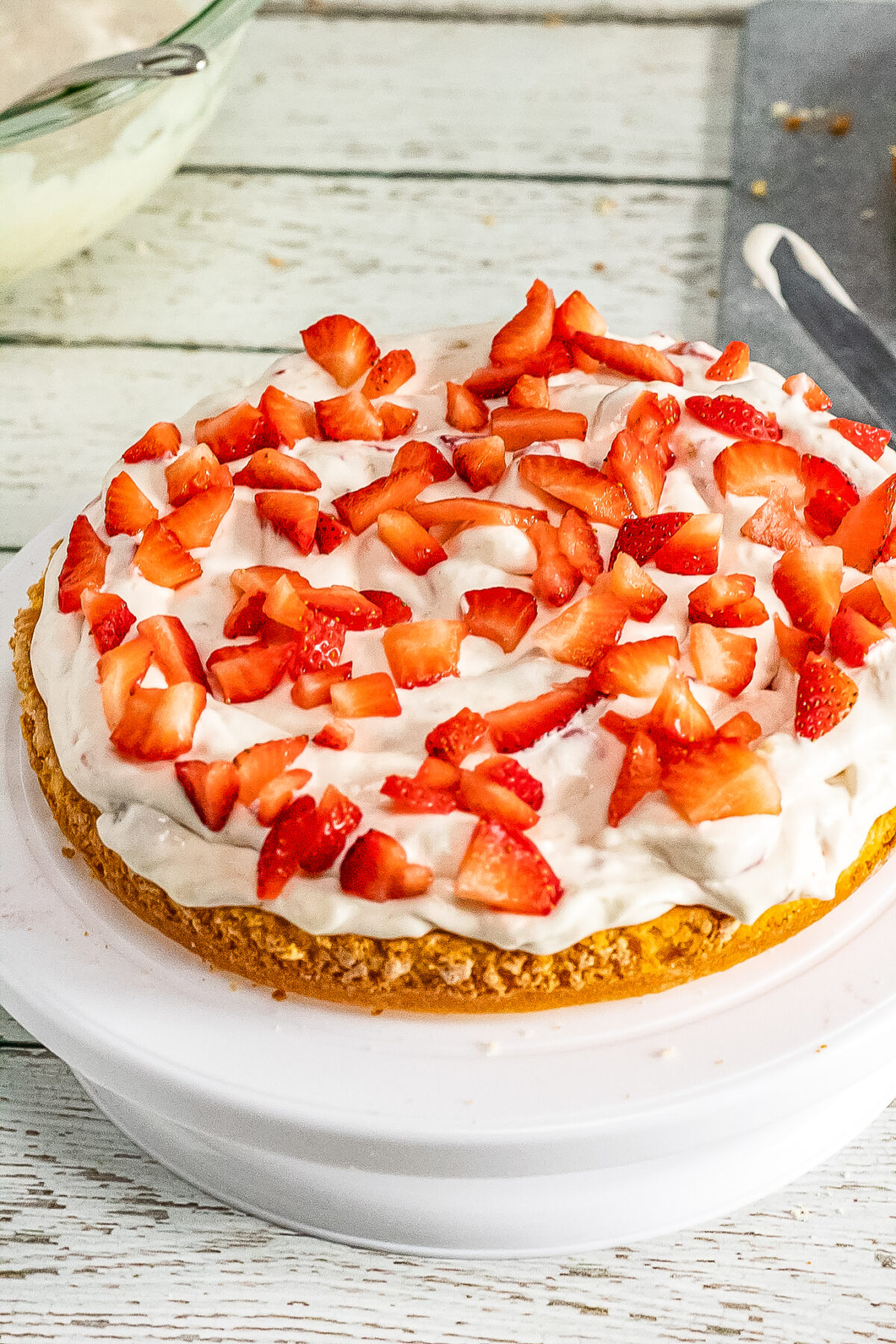 Cake topped with whipping cream and strawberries