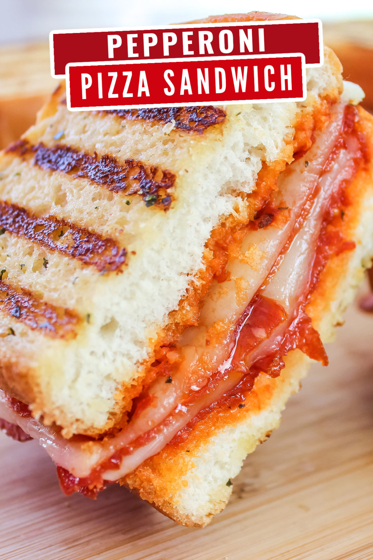 This Grilled Pepperoni Pizza Sandwich is a fun way to eat an old favourite! This easy to make recipe is a tasty spin on a grilled cheese.