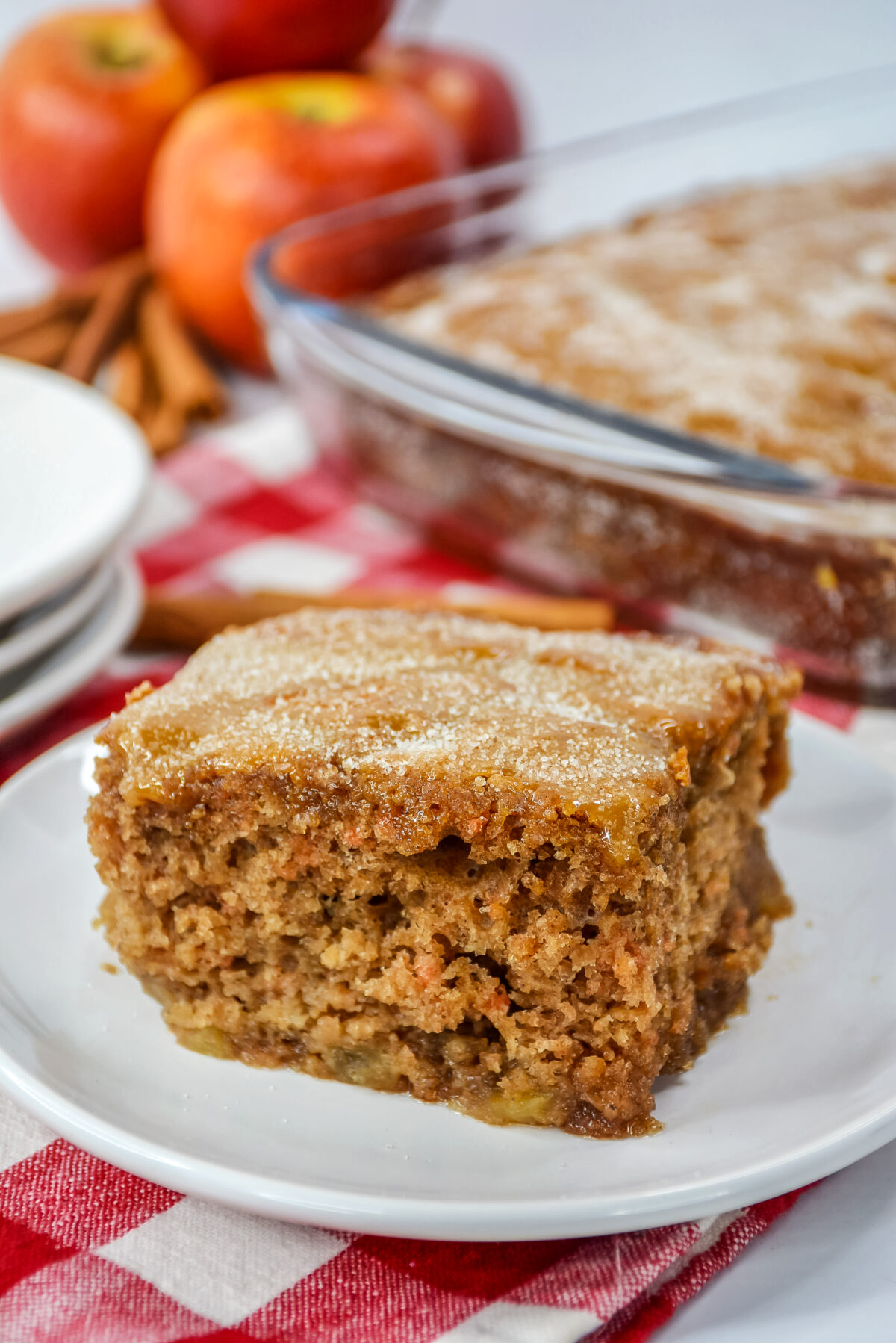 This cinnamon apple cake recipe is sure to become a family favorite! It's loaded with apples and topped off with a sweet sugar crust.