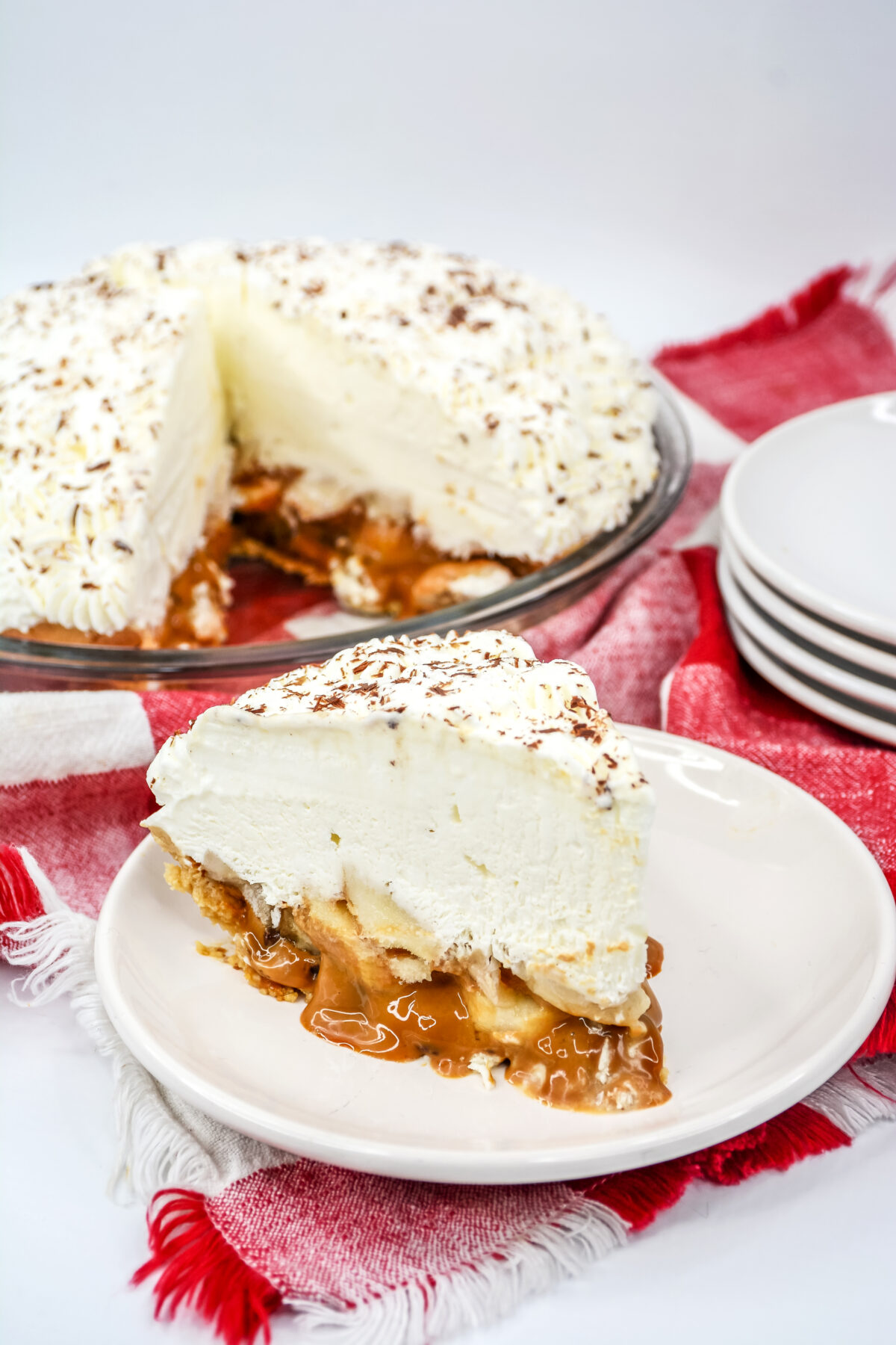 A classic English dessert, this banoffee pie recipe is easy to make and combines the taste of toffee, bananas, and cream into a tasty treat.