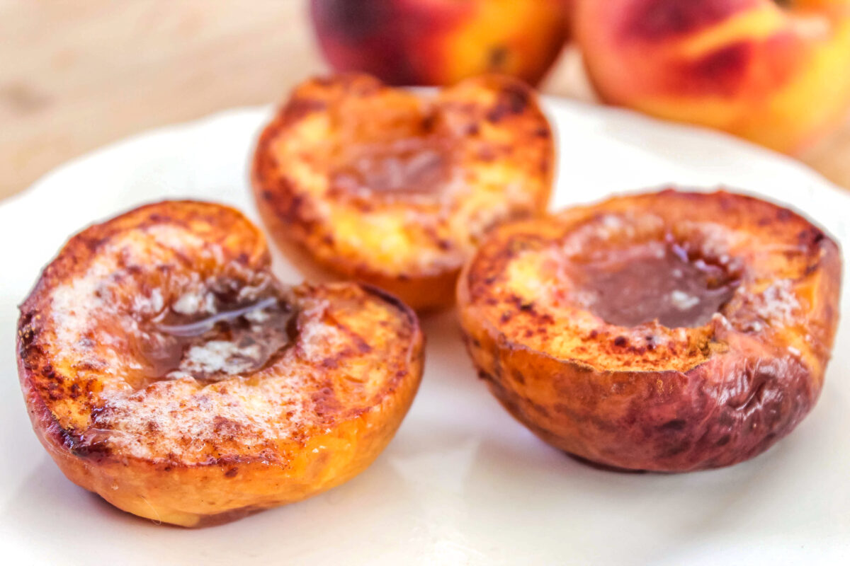 Make this delicious Baked Peaches with Cinnamon Sugar Recipe for an easy warm fruit that can be served for breakfast or dessert.