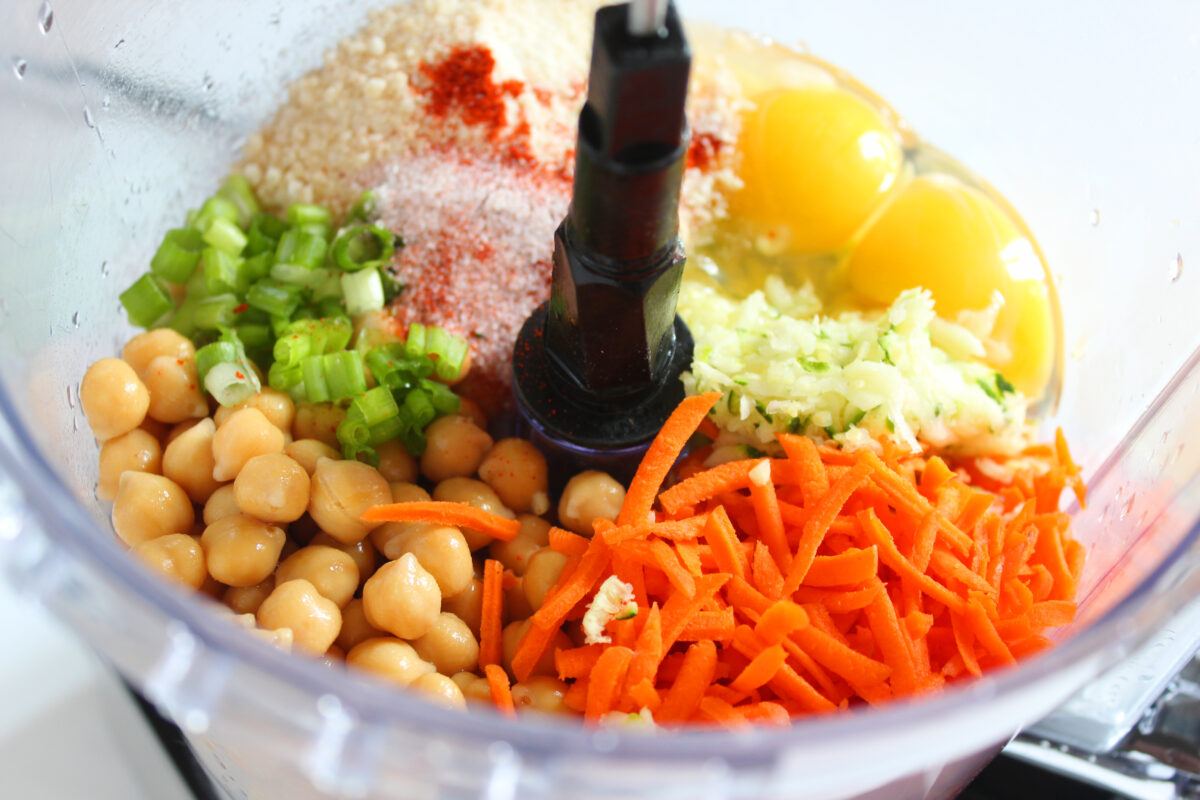 ingredients for veggie nuggets in a food processor.